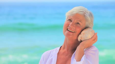 depositphotos_23499763-Elderly-woman-listening-to-a-shell